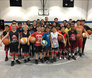 youth basketball team posing for a picture